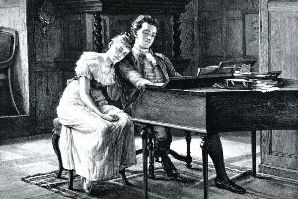 Couple sitting at the piano