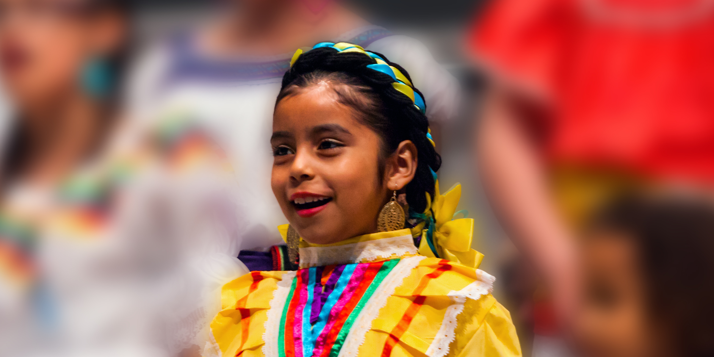 Singing girl wearing Mexican dress