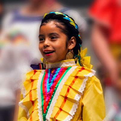 Girl singing wearing Mexican dress
