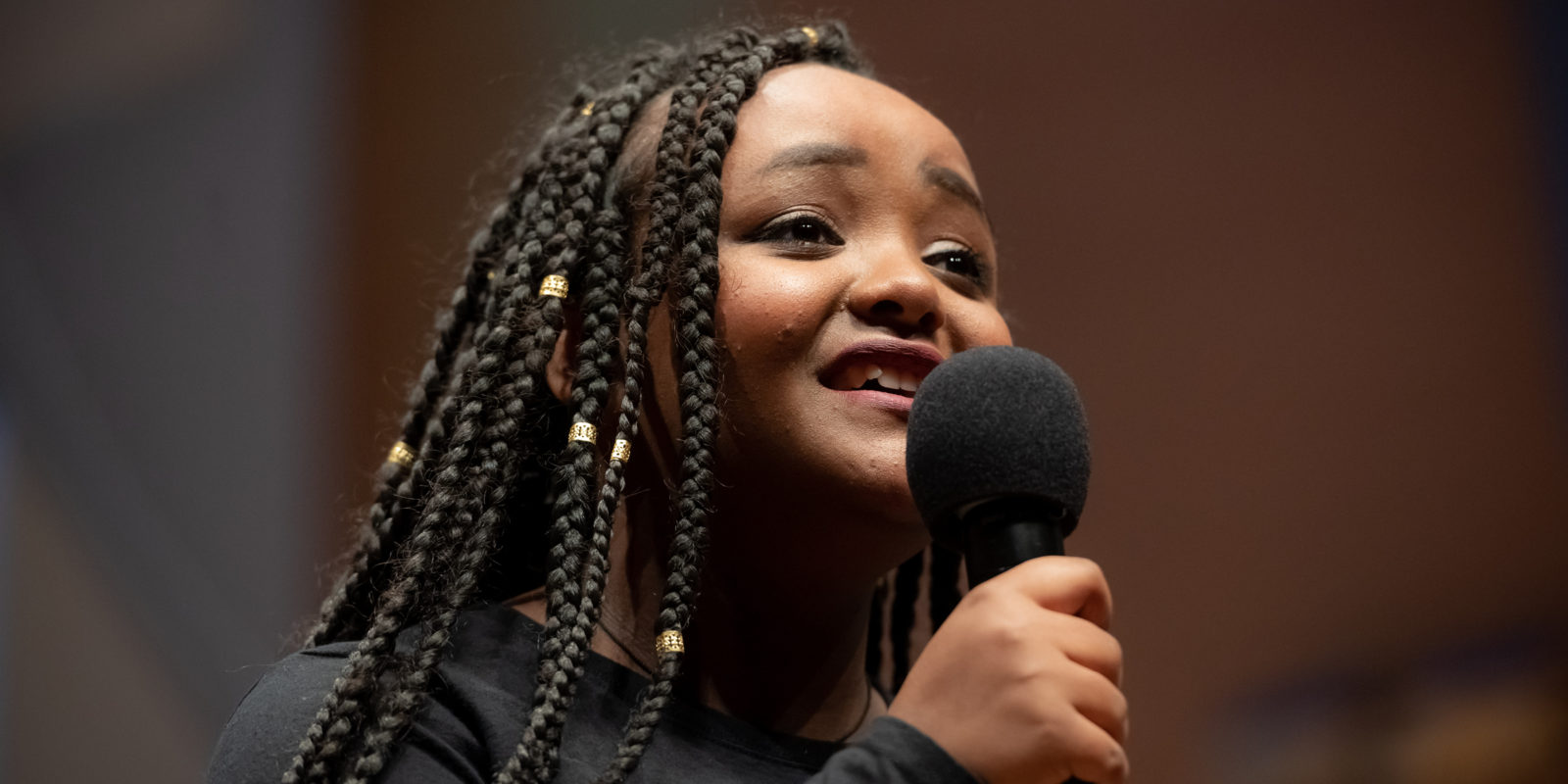 African American young woman singing