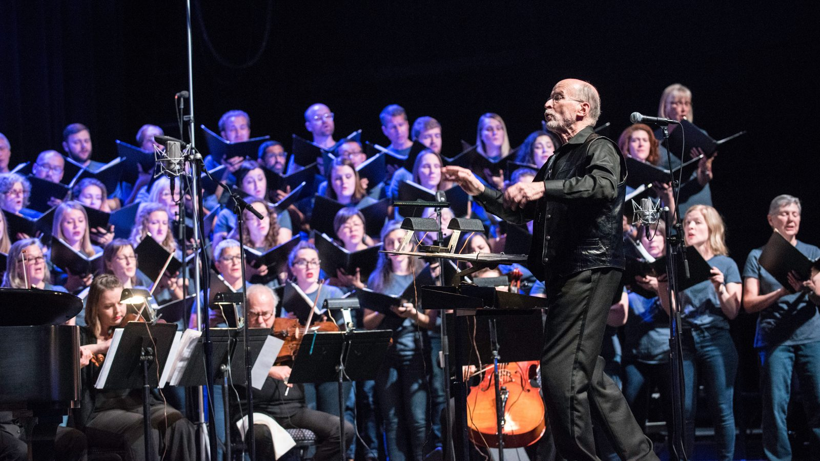 Conductor in front of singers and instrumentalists